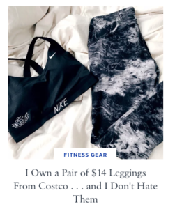 Black marbled leggings and a Nike sports bra laying flat on a bed